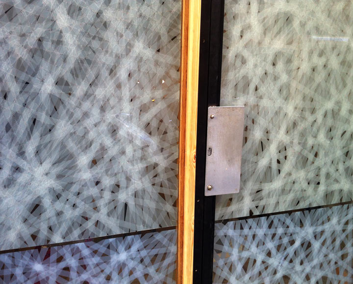 Glass door crisscrossed with magic tap